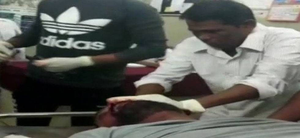 Sweeper (in white dress) stitching wounds of a patient in Bharuch Civil Hospital (Photo: ANI)
