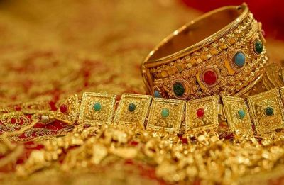 Slack demand pulls down gold prices; silver steady