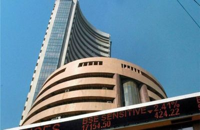 Sensex extends losses, cracks over 450 points; Nifty nears 11,000