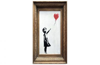 Banksy artwork shreds itself after selling for 1 million pound at auction
