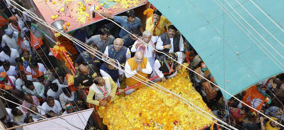 Amit Shah in Madhya Pradesh LIVE: BJP chief starts roadshow in Guna amid massive crowd (Photo: Twitter)