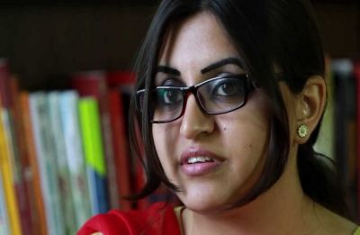 Award-winning rights activist detained as she returns to Pakistan