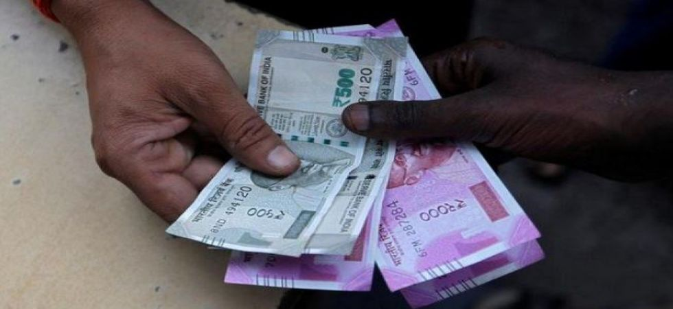 Rupee falls 19 paise to 73.35 against US dollar in early trade