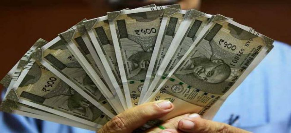 Rupee rises 11 paise to 73.84 against US dollar
