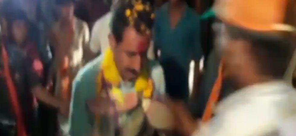 Watch: Madhya Pradesh BJP MLA Dilip Shekhawat greeted with a garland of shoes (ANI video grab)