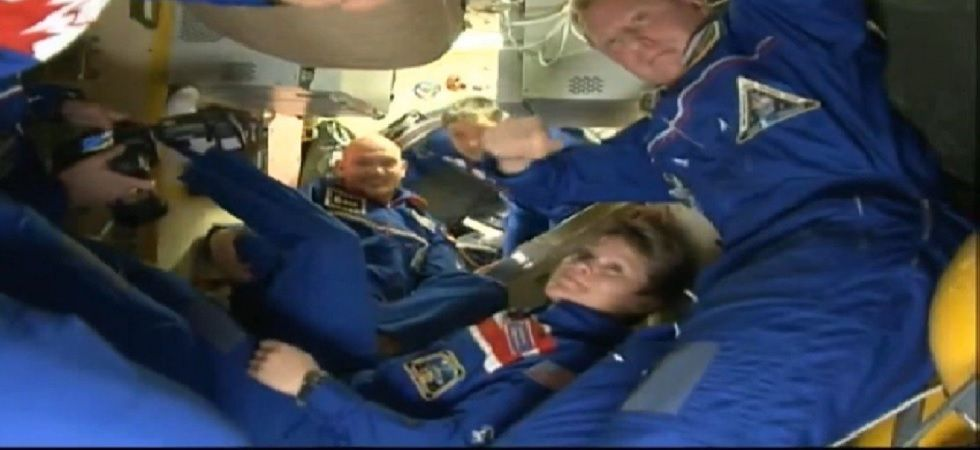 McClain, Saint-Jacques and Konenenko docked to the space station's Poisk module (Photo: Twitter@roscosmos)