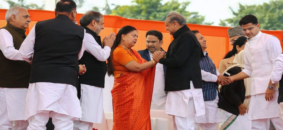 New Rajasthan Chief Minister Ashok Gehlot is greeted by former chief minister Vasundhara Raje after the swearing-in ceremony, at Albert Hall in Jaipur (PTI Photo)