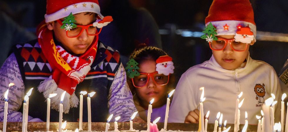 Children light candles at the Sacred Heart Cathedral on the eve of Christmas Day in New Delhi, Monday, December 24, 2018. (PTI Photo)