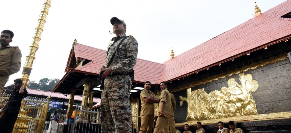 A security personnel stands guard at the Sabarimala temple in Kerala's Pathanamthitta district. (IANS file photo)