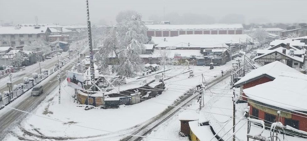 The snowfall, which began on Friday, continued in most parts of the valley till Saturday morning. (ANI Photo)
