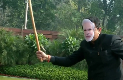 Watch | Trinamool Congress MPs protest Citizenship Bill with PM Modi mask, stick