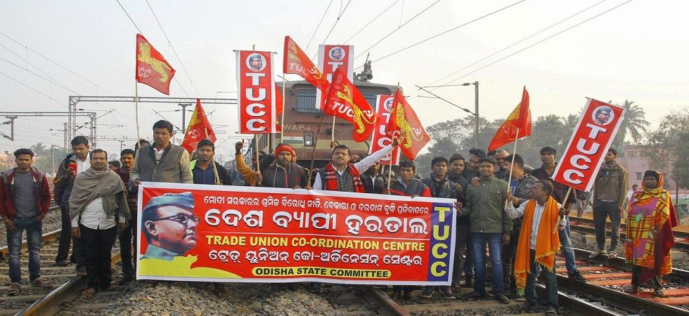Trade union activists block a train in Bhubaneswar on Tuesday. ( PTI)