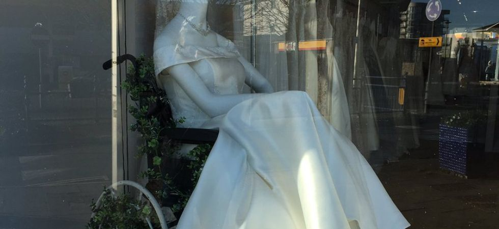 This bridal shop displays one of its wedding dresses on a mannequin seated in a wheelchair./ Image: Twitter