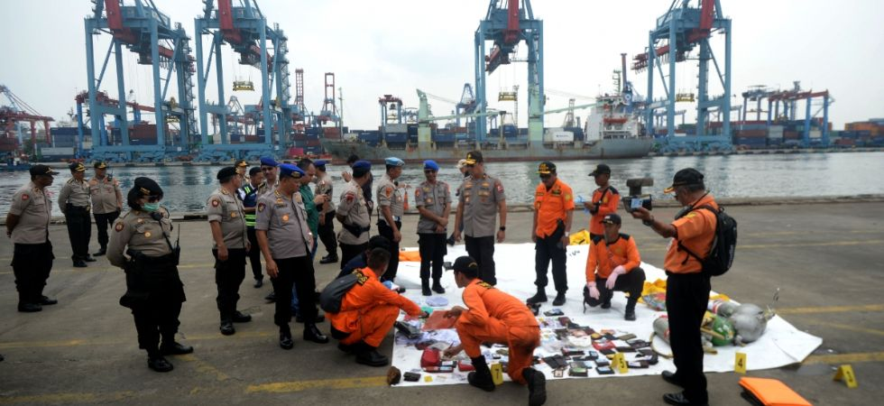 Indonesian Search and Rescue (SAR) members and police officers check belongings of Lion Air Flight JT 610 victims at Jakarta International Container Terminal (JICT) in Tanjung Priok, Jakarta, Indonesia, on Oct. 30, 2018. (IANS file photo)