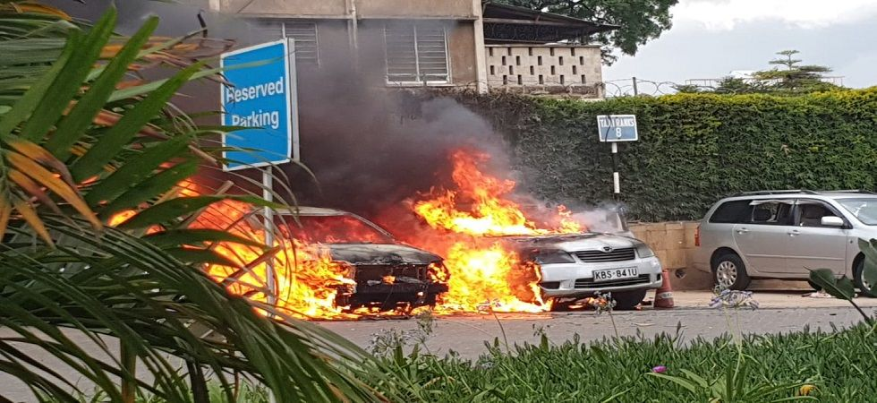 Gunfire and explosion reported on 14 Riverside Drive off Chiromo Road, Nairobi, four cars destroyed; police on site. (KTN)