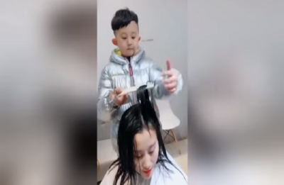WATCH | This six year from China is a born hairdresser, wins the internet with his impressive haircutting skills