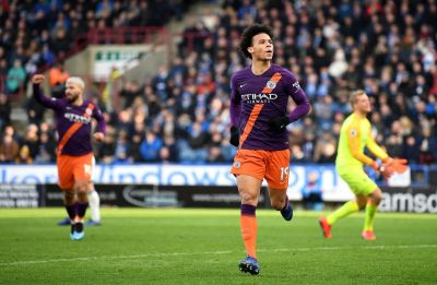 Manchester City cut Liverpool's lead in Premier League, beat Huddersfield Town