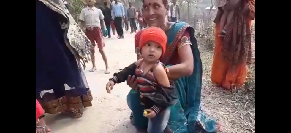Assam security personnel makes 3-year-old take off jacket, video goes viral (Photo Source: Twitter)