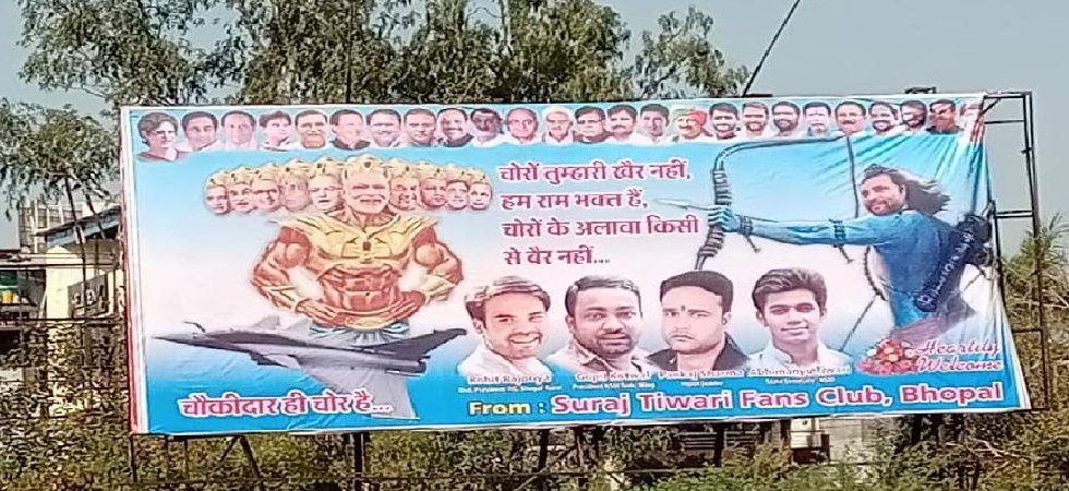 Poster seen in Bhopal portraying Congress President Rahul Gandhi as Lord Rama and PM Narendra Modi as Ravana. (Photo: ANI)