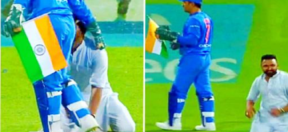 Running high on emotions, the trespasser was able to touch MS Dhoni's feet but in doing that, the Indian flag in his right hand brushed the ground.