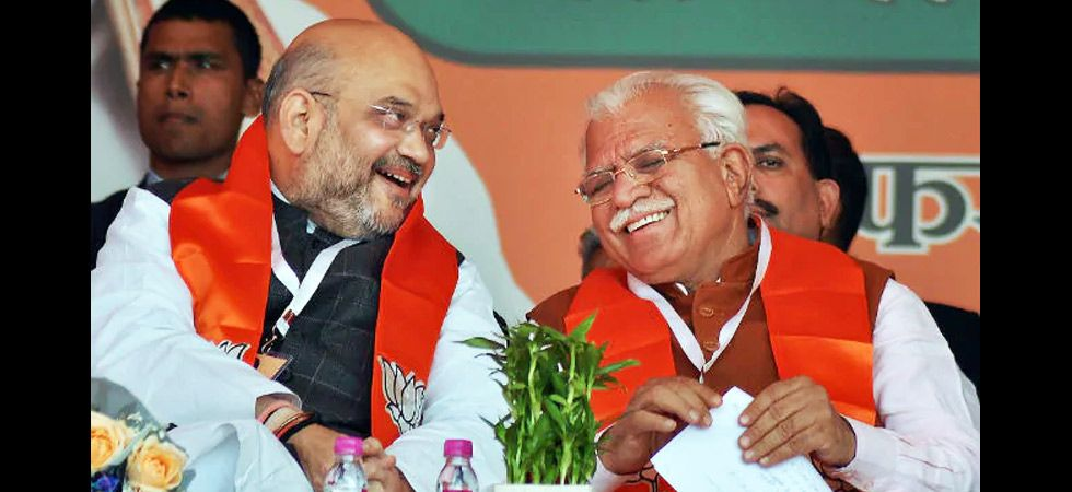 BJP president Amit Shah with Haryana Chief Minister Manohar Lal Khattar. He became the first BJP chief minister of the state after the Assembly elections in 2014. (File photo: PTI)