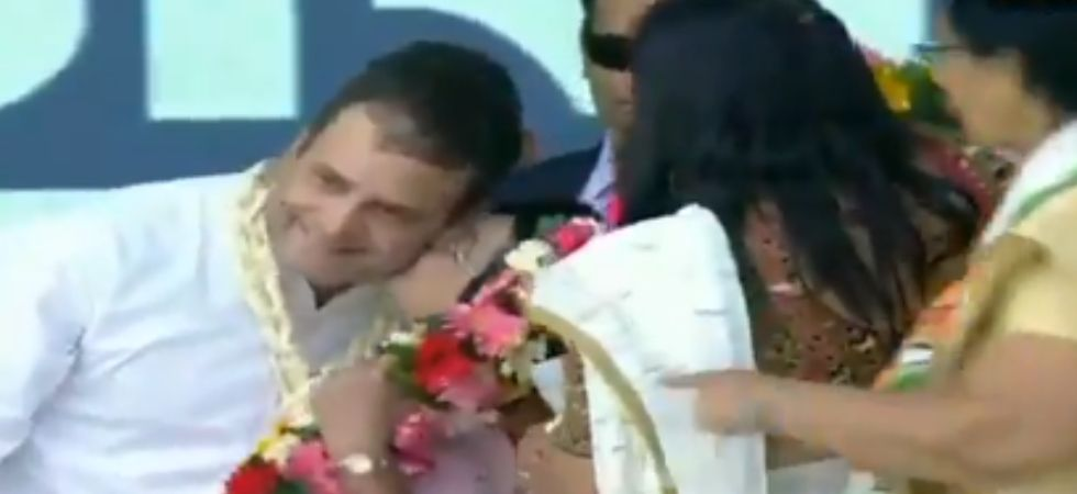 Rahul Gandhi was planted a kiss on cheek during a rally in Gujarat. (Image Credit: ANI)