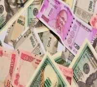 Rupee opens 18 paise lower at 70.18 against US dollar
