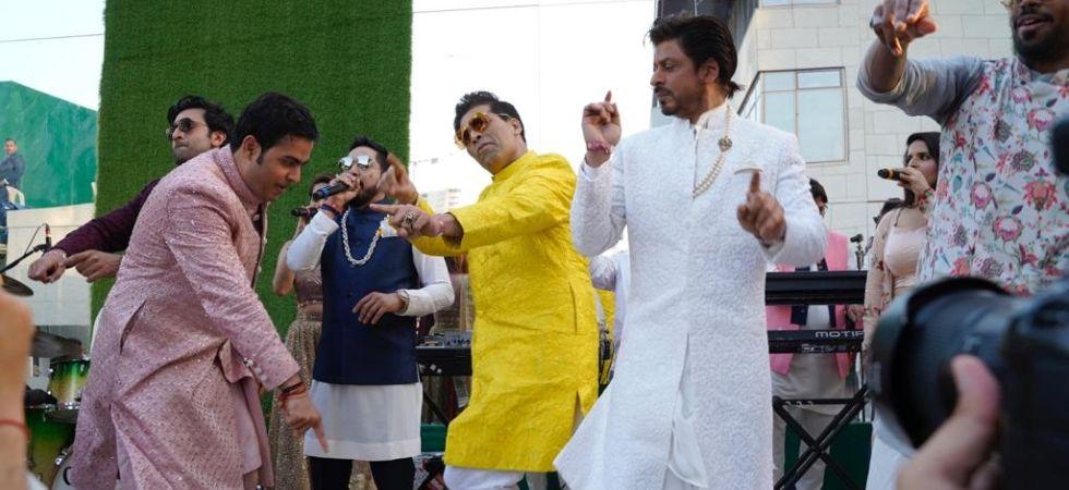 Shah Rukh Khan and Ranbir Kapoor dance with Akash Ambani at his wedding./ Image: IANS