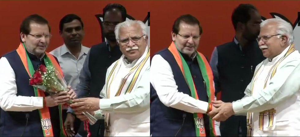 Haryana Chief Minister Manohar Lal Khattar welcomed Arvind Kumar Sharma into the BJP fold. (Photos: ANI)