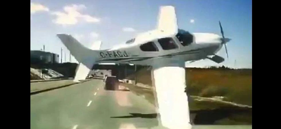 Plane narrowly misses truck's front on highway before crashing./ Image: Instagram