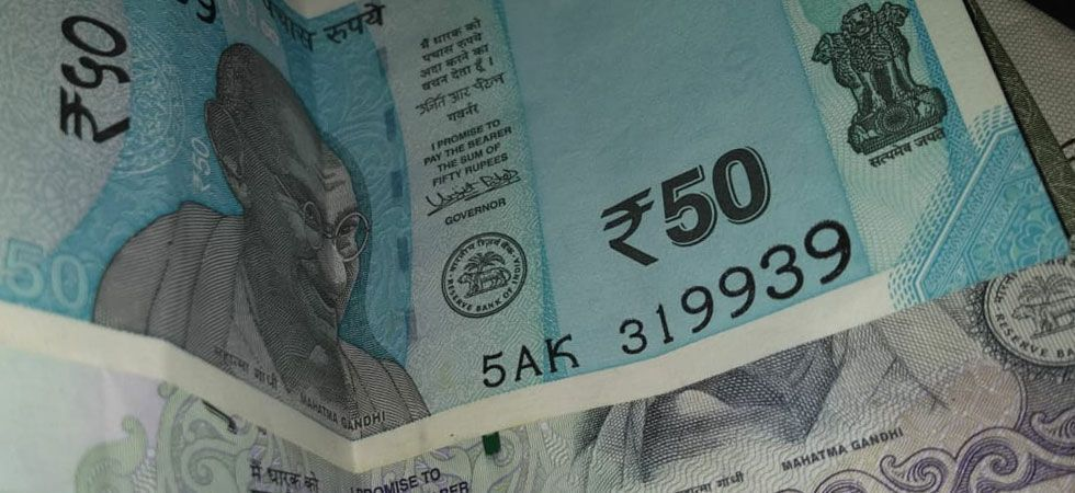 The rupee depreciated by 12 paise to 68.98 against the US dollar in early trade on Wednesday