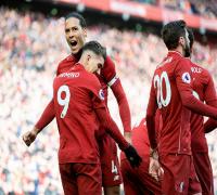 Liverpool face Tottenham Hotspur test in quest for Premier League title