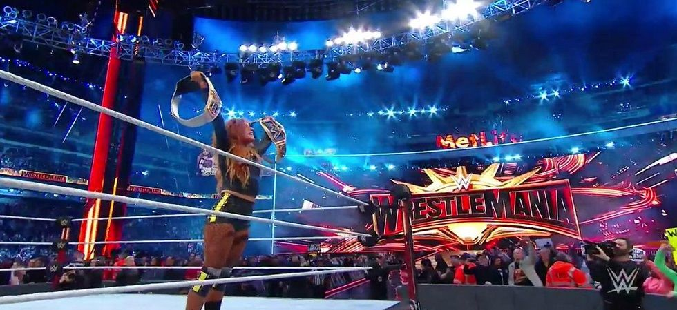 Becky Lynch won the winner takes it all contest against Charlotte Flair and Ronda Rousey to become the new Raw and Smackdown Women's champion. (Image credit: Wrestlemania Twitter)