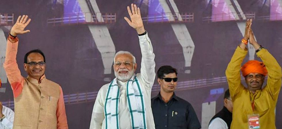 Prime Minister Narendra Modi with former Madhya Pradesh chief minister Shivraj Singh Chouhan. Madhya Pradesh will vote in four phases on April 29, May 6, 12 and 19. (File photo: PTI)