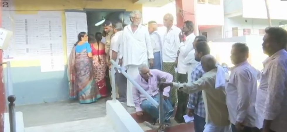 People queue up at a polling booth in Amaravati to cast their votes. (Photo:ANI)
