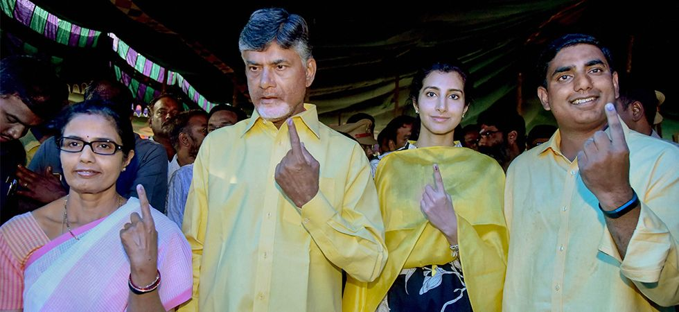 Chandrababu Naidu and his family members show their finger marked with indelible ink after casting vote