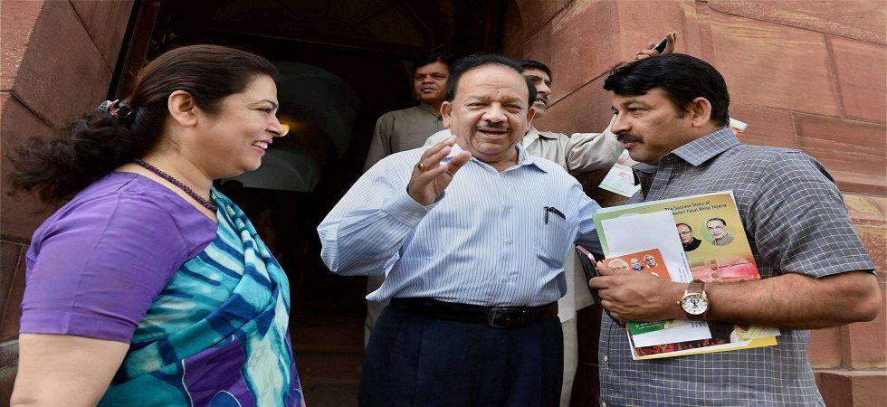 Meenakshi Lekhi, Manoj Tiwari and Harsh Vardhan. (PTI/file)