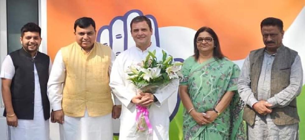 Former BJP MP from Hamirpur, Suresh Chandel with Congress president Rahul Gandhi. (ANI Photo)