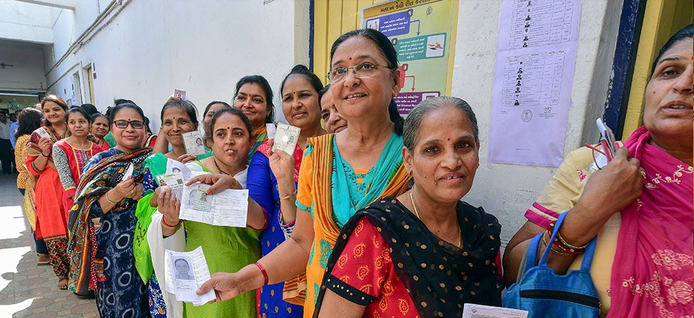 Women voters queue up to cast their votes in Ahmedabad