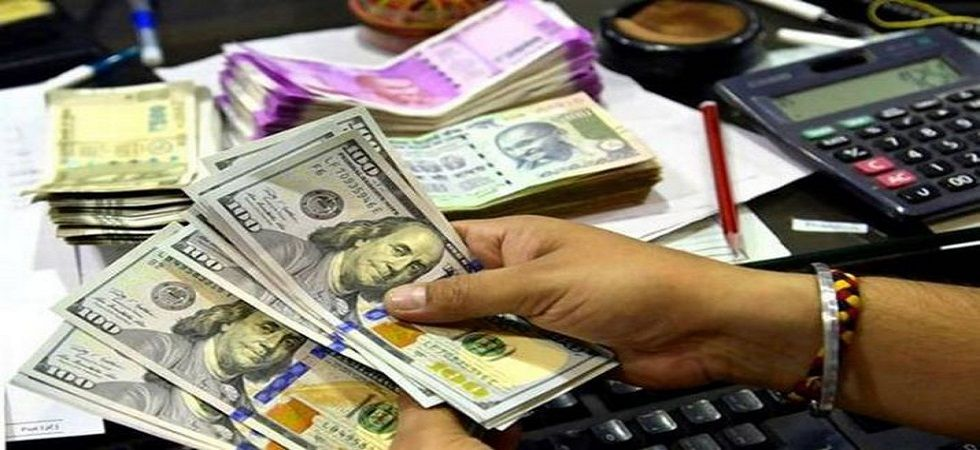 he dollar index, which gauges the greenback's strength against a basket of six currencies, rose 0.03 per cent to 97.66. (File photo)