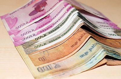 Rupee rises 23 paise to 70.02 against US Dollar