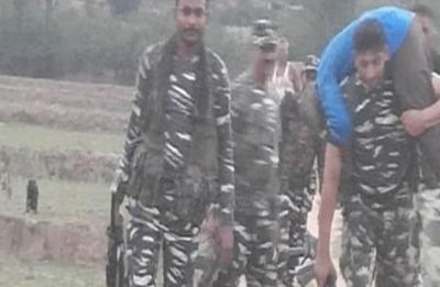 CRPF jawan walks 3 km carrying polling official on shoulder to save his life