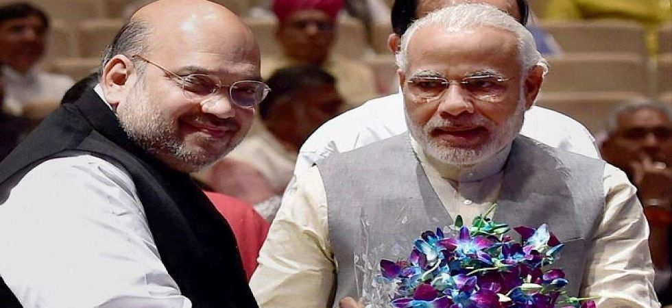 Prime Minister Narendra Modi (Right) and BJP president Amit Shah (PTI Photo)