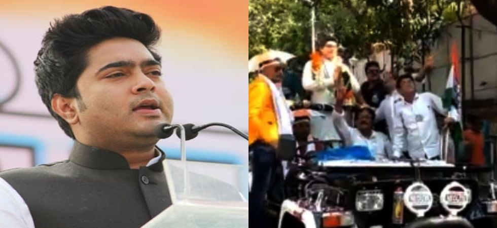 Abhishek Banerjee's statue, with garlands around its neck and folded hands, stands mounted on an open jeep with supporters raising slogans for him.