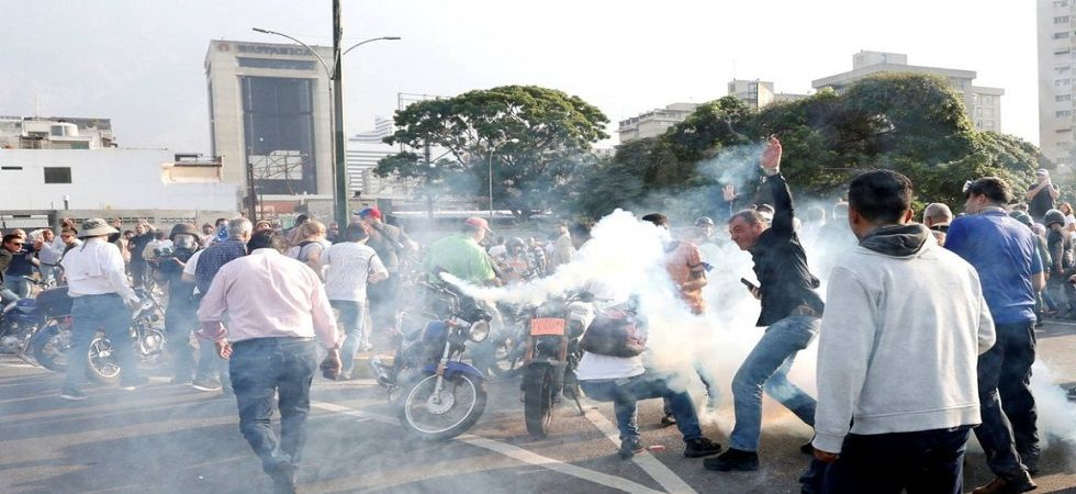 A second day of confrontations between opposition supporters and Maduro's security services came as the United States said it was prepared to take military action, if necessary, to stem the crisis in the South American nation. (Photo: Twitter/@CaracasCh