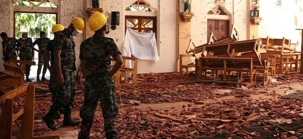 Security personnel inspecting one of the churches where the blasts occurred (PTI Photo)