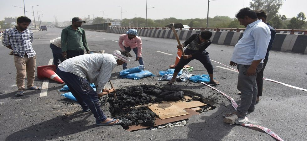 During inspection, it appeared that thin iron bars, lower-quality concrete materials and thin layers of charcoal are clearly visible on the road. (Photo: IANS)