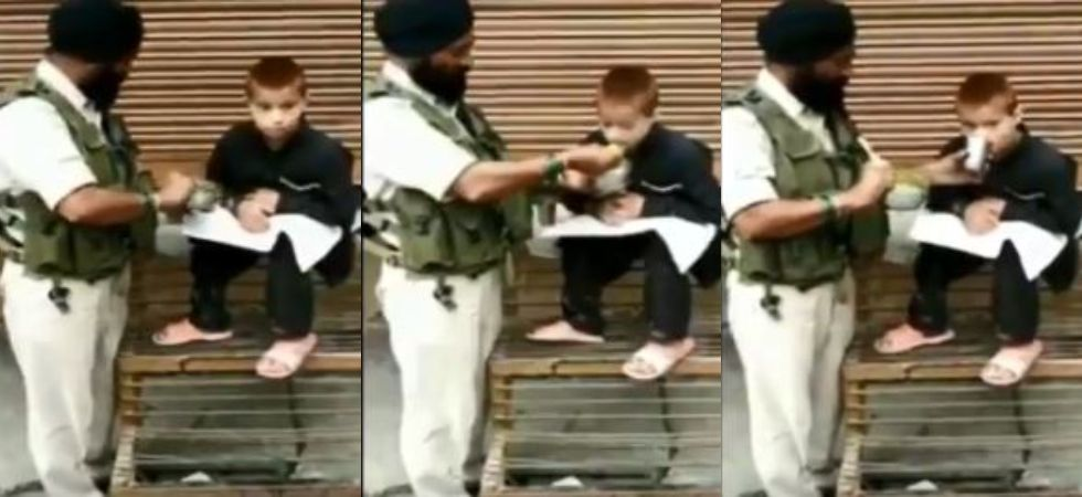 Havaldar Iqbal Singh feeds paralytic child in Srinagar (Photo Credit: Twitter)