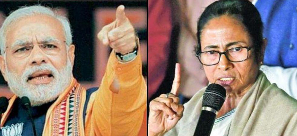 Prime Minister Narendra Modi (Left), West Bengal Chief Minister Mamata Banerjee (Right)