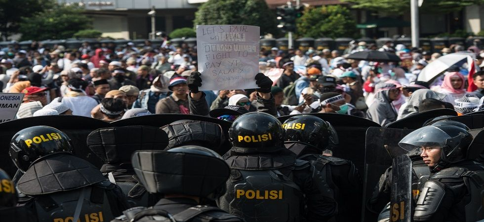 The police block protesters who crowd Thamrin street in front of the Election Supervisory Board building during their rally to reject the result of the national vote recapitulation in Jakarta, Indonesia on Tuesday. (Photo: IANS)